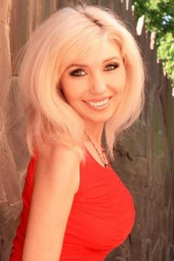 Ukrainian girl Anna,45 years old with green eyes and blonde hair.