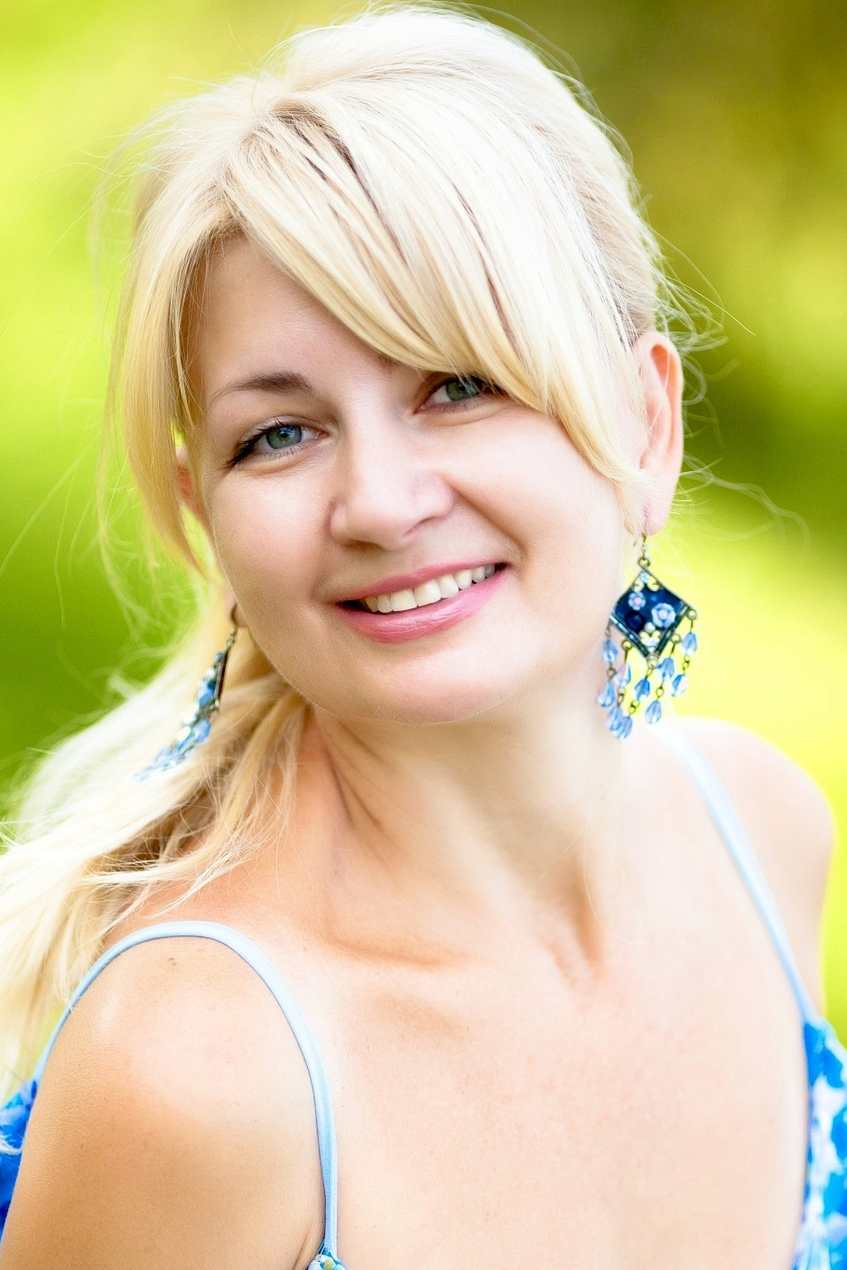 Ukrainian girl Larisa,54 years old with green eyes and blonde hair.