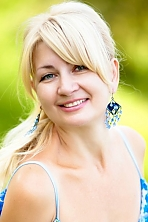 Ukrainian girl Larisa,54 years old with green eyes and blonde hair.