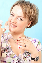 Ukrainian girl Nonna,33 years old with brown eyes and light brown hair.