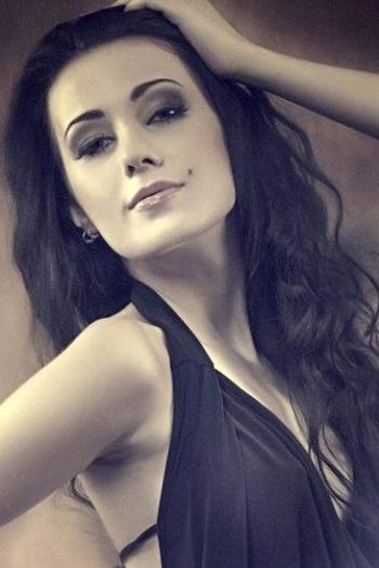 Ukrainian girl Katarina,24 years old with green eyes and dark brown hair.