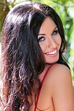Ukrainian girl Alena,28 years old with green eyes and black hair.
