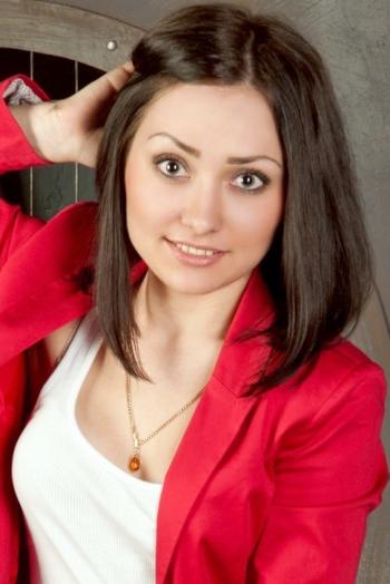 Ukrainian girl Natalya,24 years old with green eyes and dark brown hair.