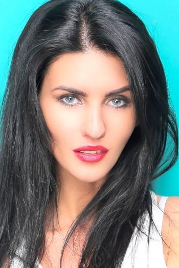 Ukrainian girl Anastasia,26 years old with blue eyes and black hair.