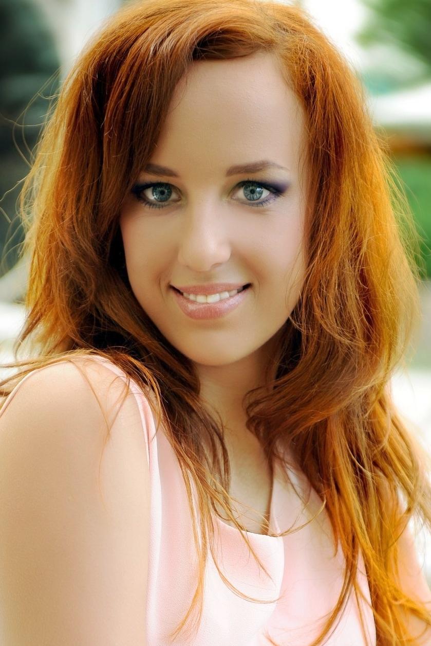 Ukrainian girl Tatiana,28 years old with blue eyes and dark brown hair.