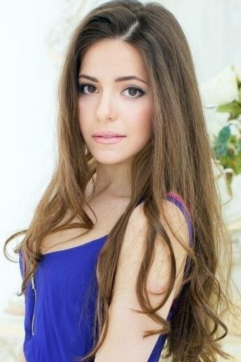Ukrainian girl Olga,23 years old with brown eyes and dark brown hair.