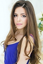 Ukrainian girl Olga,23 years old with brown eyes and dark brown hair.