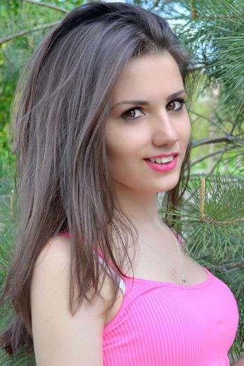 Ukrainian girl Evgenia,22 years old with brown eyes and dark brown hair.