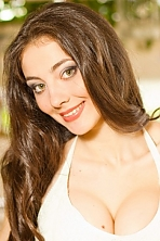 Ukrainian girl Anna,21 years old with green eyes and dark brown hair.