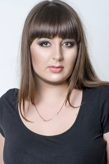 Ukrainian girl Olga,24 years old with green eyes and dark brown hair.