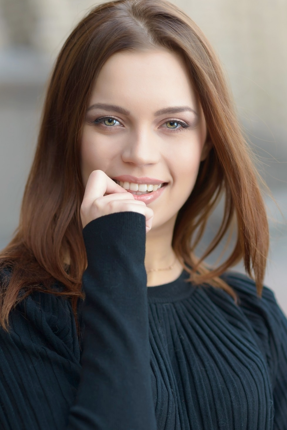 Ukrainian girl Victoria,23 years old with green eyes and dark brown hair.
