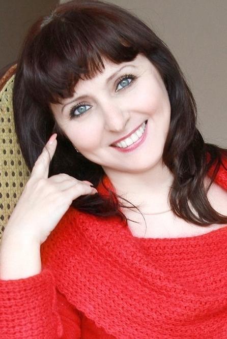 Ukrainian girl Irina,51 years old with grey eyes and dark brown hair.