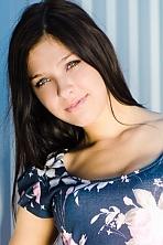 Ukrainian girl Marina,24 years old with green eyes and dark brown hair.