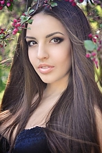 Ukrainian girl Tatiana,21 years old with brown eyes and dark brown hair.