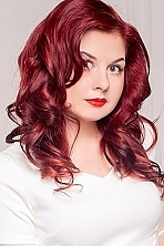 Russian girl Anna,27 years old with green eyes and red hair.