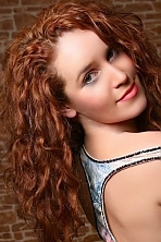 Ukrainian girl Elena,29 years old with green eyes and red hair.