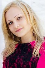 Ukrainian girl Nikitina,31 years old with green eyes and blonde hair.