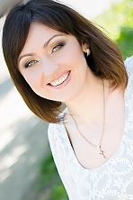 Ukrainian girl Elena,35 years old with green eyes and light brown hair.