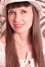 Ukrainian girl Inessa,34 years old with grey eyes and black hair.