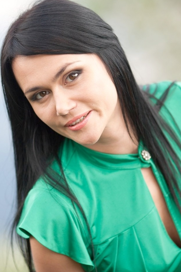 Ukrainian girl Olga,33 years old with hazel eyes and black hair.
