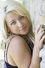 Ukrainian girl Oksana,44 years old with grey eyes and blonde hair.