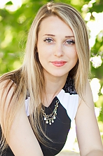 Ukrainian girl Tatiana,26 years old with green eyes and blonde hair.