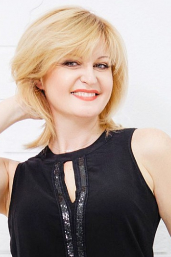 Ukrainian girl Elena,45 years old with brown eyes and blonde hair.