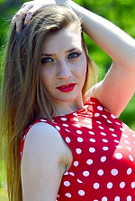 Ukrainian girl Ksenia,25 years old with green eyes and light brown hair.