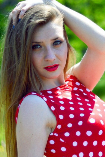 girl Ksenia, years old with  eyes and  hair.