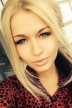 Ukrainian girl Inna,24 years old with brown eyes and blonde hair.