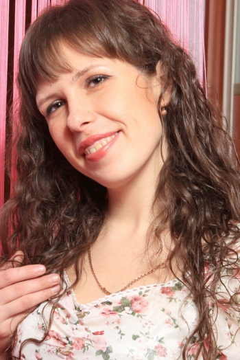 Ukrainian girl Lidiya,31 years old with brown eyes and dark brown hair.