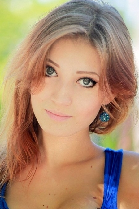 Ukrainian girl Anna,25 years old with grey eyes and red hair.
