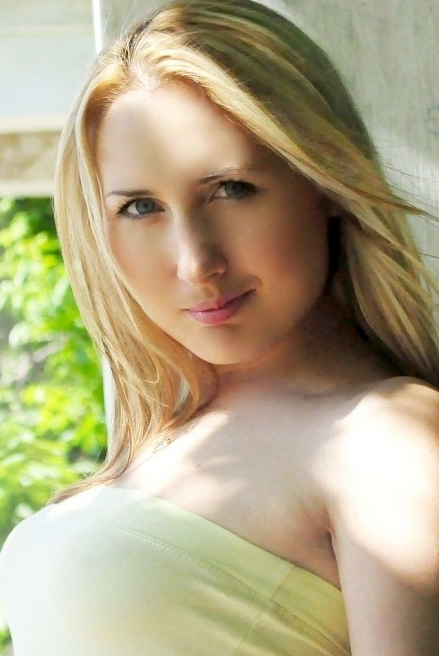 Ukrainian girl Inna,31 years old with blue eyes and light brown hair.