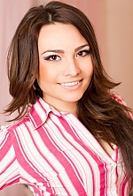 Ukrainian girl Daria,25 years old with brown eyes and dark brown hair.