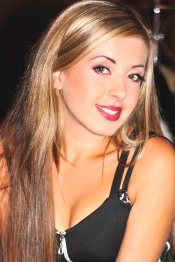 Ukrainian girl Oksana,27 years old with green eyes and light brown hair.