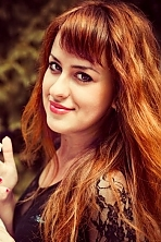 Ukrainian girl Elena,27 years old with brown eyes and red hair.