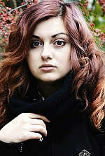 Ukrainian girl Aneliya,21 years old with brown eyes and red hair.
