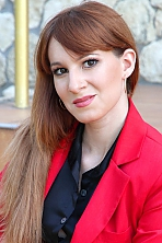 Ukrainian girl Irina,27 years old with hazel eyes and dark brown hair.