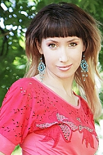 Ukrainian girl Svetlana,31 years old with hazel eyes and dark brown hair.