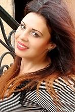 Ukrainian girl Lilia,25 years old with hazel eyes and dark brown hair.