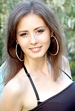 Ukrainian girl Nataliya,35 years old with brown eyes and dark brown hair.