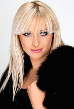 Ukrainian girl Svetlana,30 years old with blue eyes and blonde hair.