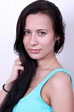 Ukrainian girl Alina,21 years old with grey eyes and dark brown hair.