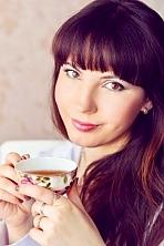 Ukrainian girl Diana,24 years old with hazel eyes and dark brown hair.