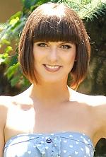 Ukrainian girl Marina,31 years old with green eyes and dark brown hair.