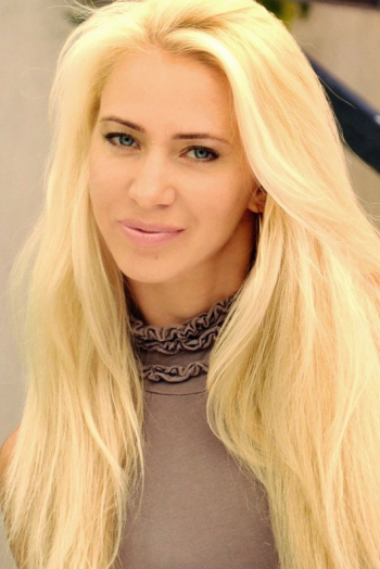 Ukrainian girl Viktoria,37 years old with grey eyes and blonde hair.