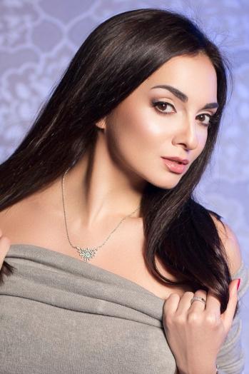 Ukrainian girl Svetlana,34 years old with brown eyes and black hair.
