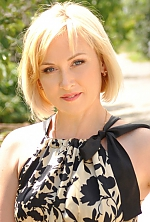 Ukrainian girl Larisa,47 years old with grey eyes and blonde hair.