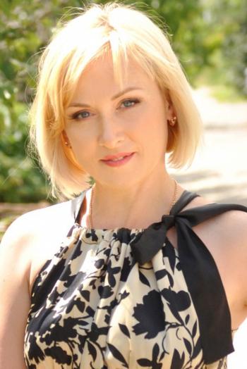 Ukrainian girl Larisa,47 years old with grey eyes and blonde hair.