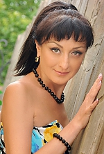 Ukrainian girl Viktoria,48 years old with grey eyes and dark brown hair.